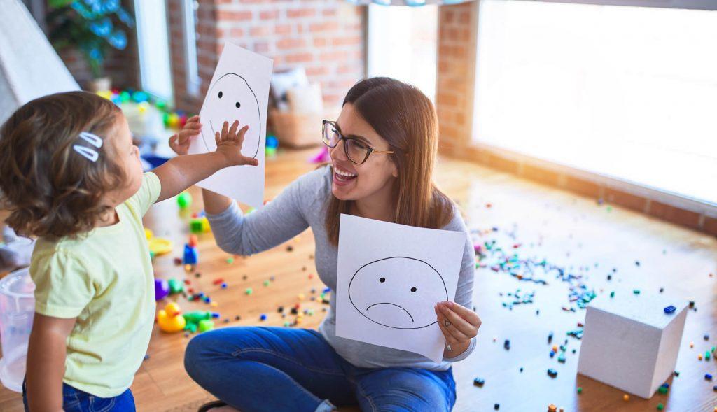 Head Start teacher in an a fun activity with a toddler