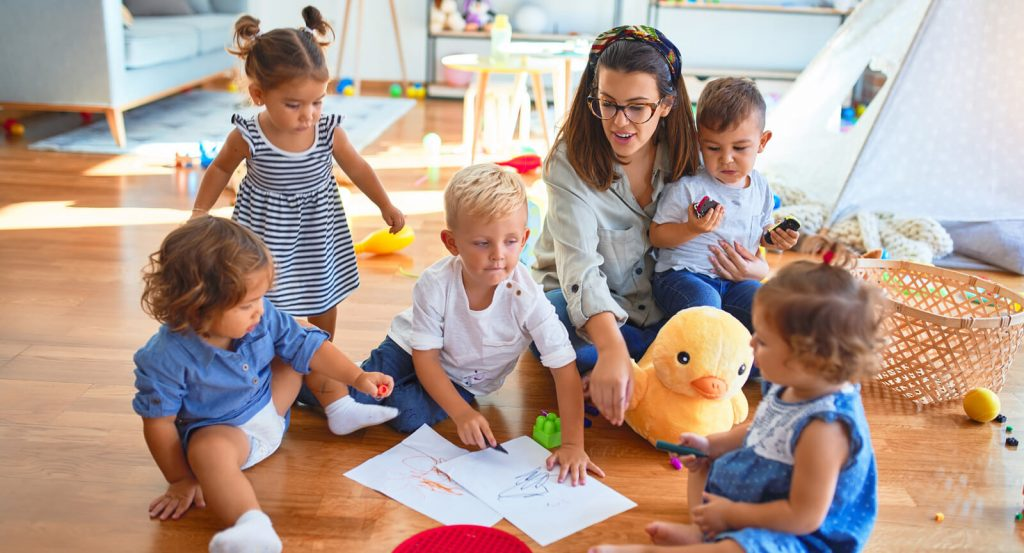Head Start teacher with a group of children
